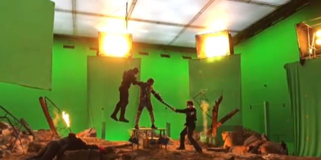 Capitán América e Iron Man luchando contra Thanos